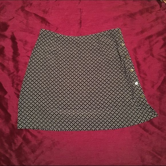 Short Flirty Skirt Adorable skirt with buttons down the side. Light weight material. Says size 10 but sized small. Merona  Skirts Mini