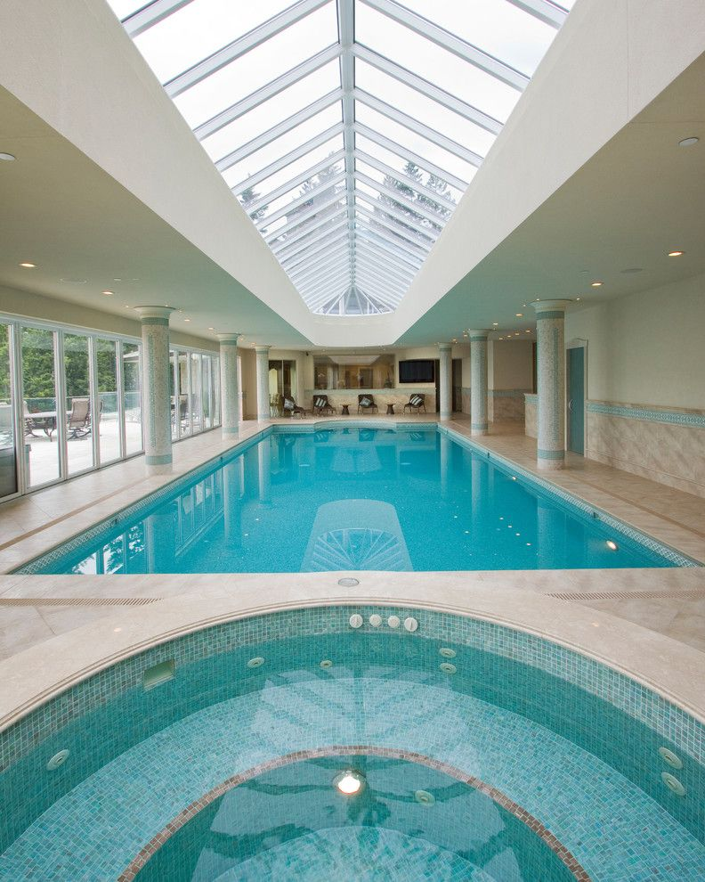 square interior pool with sliding glass enclosure round shaped spa