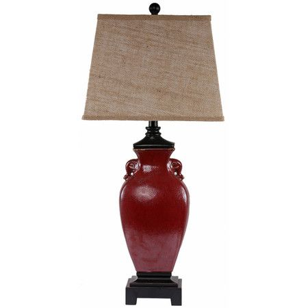 Featuring a ceramic urn-style base, this charming table lamp casts a stylish glow over your decor.Product: Table lampConst...