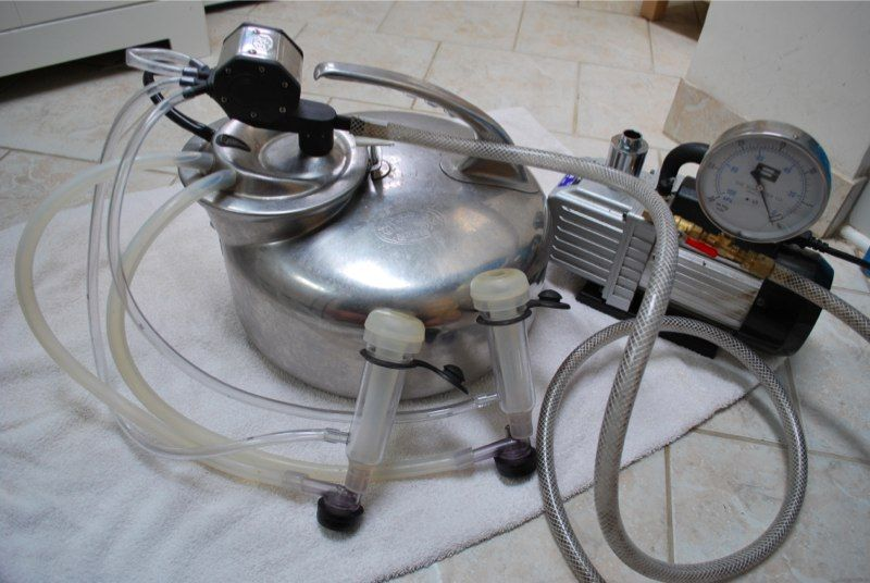 Milking Machine by Smallholderhollow -- Homemade surge bucket milking machine for milking goats, sheep, or cows. Constructed from a vacuum pump, milking bucket, pulsator, milking shells, and tubing. http://www.homemadetools.net/homemade-milking-machine