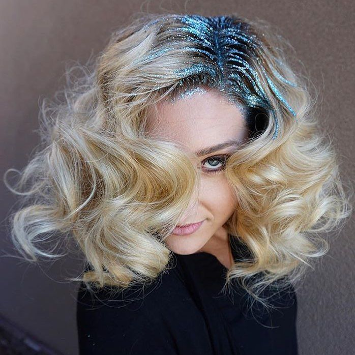 We all have seen the glitter root trend on edgier styles but check out this soft, gorgeous look rocking it just as hard!! I'm in love! Replicate this look by curling hair with a 1 inch curling iron and set curl to the scalp with a pin or clip. Let cool and remove then brush out hair with a soft bristle brush to achieve that fluffy look. Dust on some Big Sexy Hair Powder Play to the roots and massage in. Finish with some  Big Sexy Hair Spray and Play for all day hold. Apply glitter as…