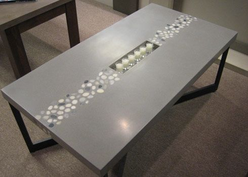 custom coffee table made form #concrete and river rocks. custom