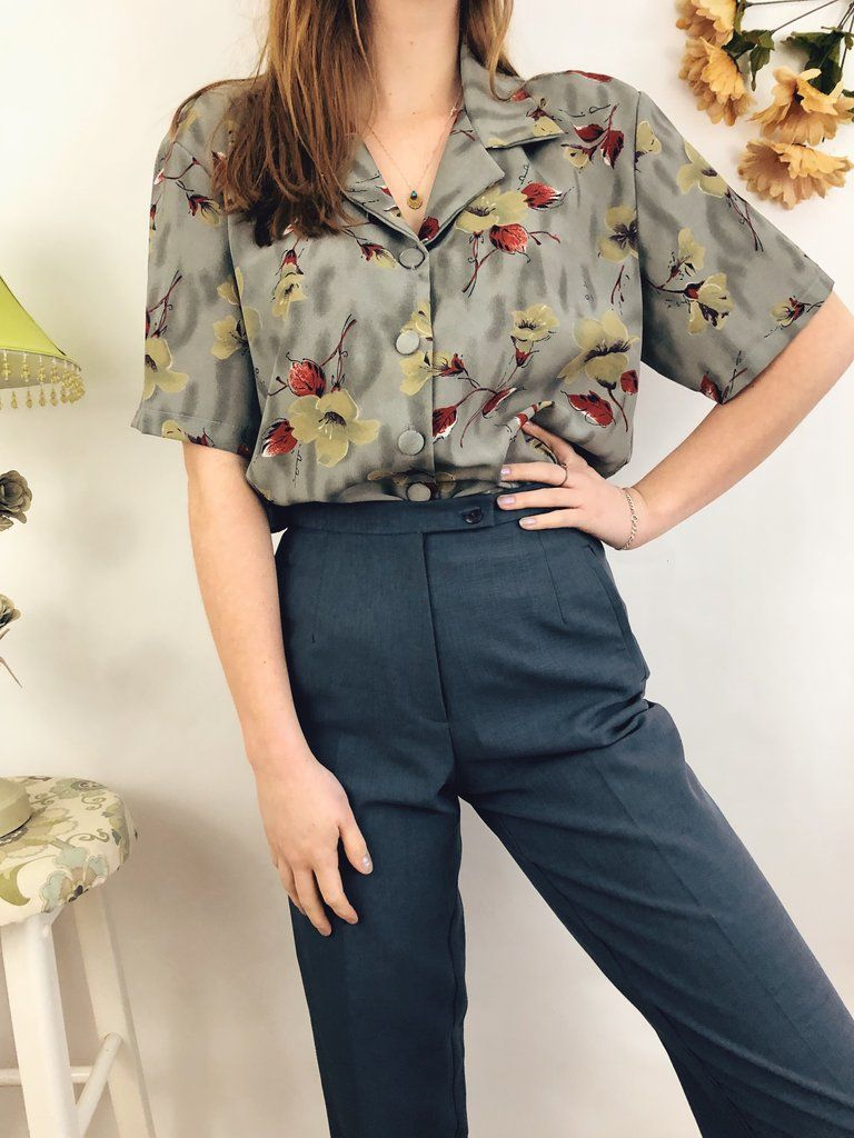 74478acc21815 Vintage Muted Floral Top. A charming vintage floral top with muted shades  and pops of red. Perfect tucked into trousers. fall outfit ideas