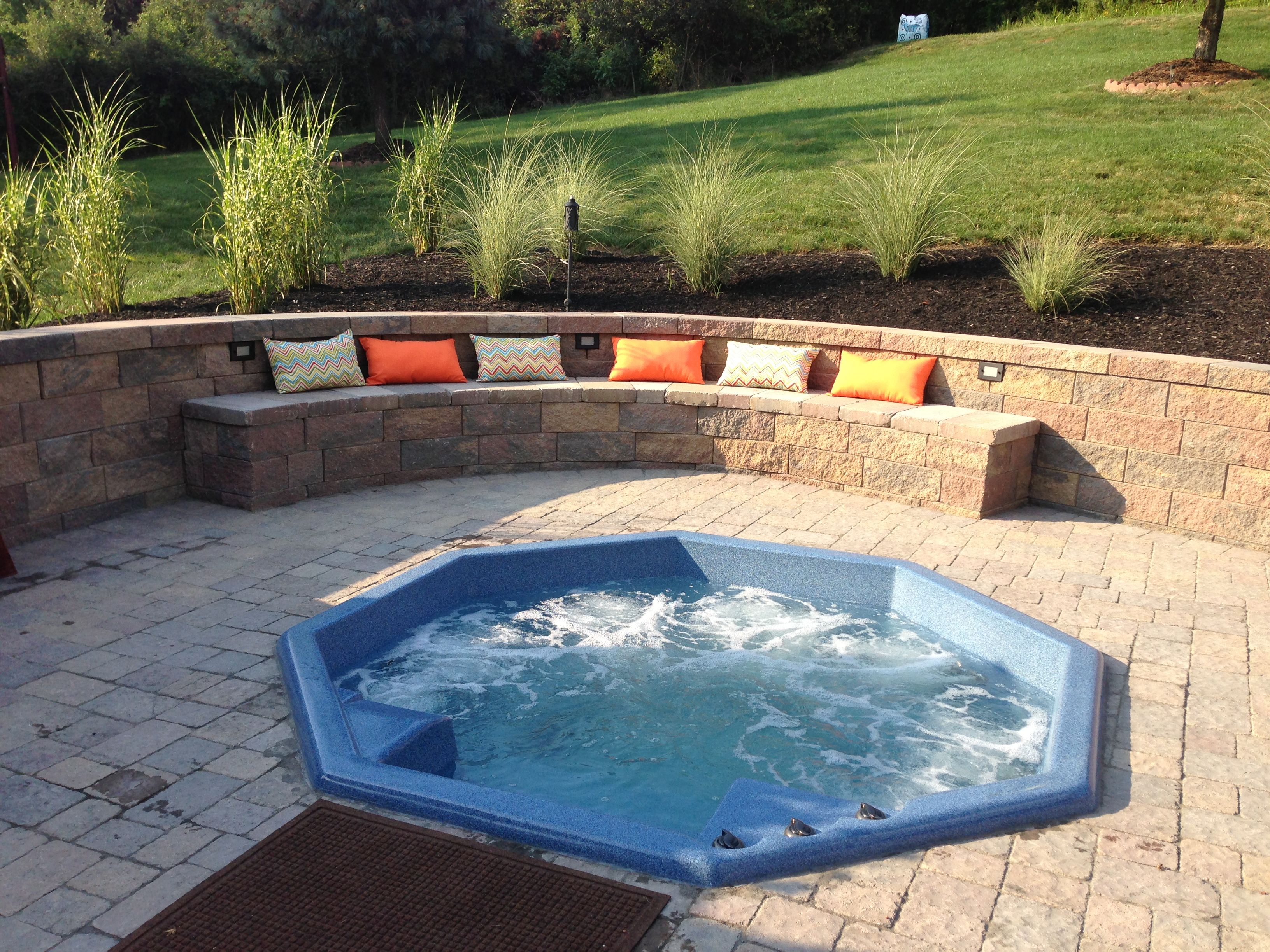 backyard entertaining area sunken hot tub jacuzzi with built in seating and retaining wall. Black Bedroom Furniture Sets. Home Design Ideas