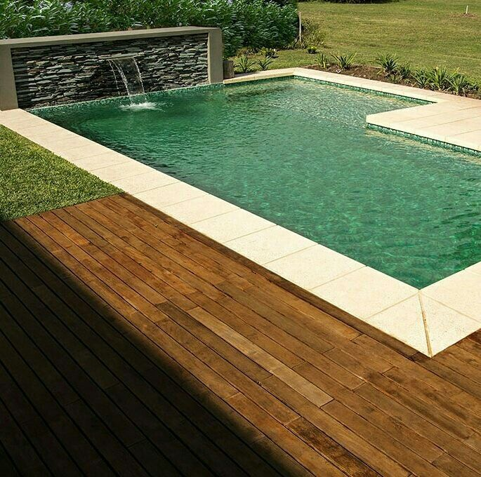 Rectangular Swimming Pool With A Cascade In Dark Natural Stone