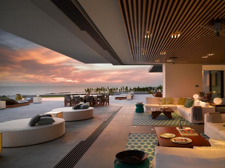 Maison neuve avec vue sur lu0027eau à lu0027architecture inspirée des années - dalle beton interieur maison