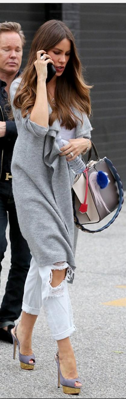Who made Sofía Vergara's ripped blue jeans, gray handbag