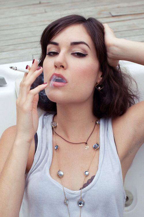 Sasha Grey smoking a cigarette (or weed)