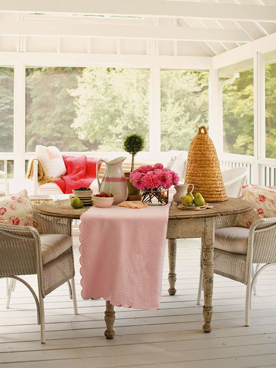 An all-white porch gets a jolt of energy thanks to pretty pink accessories. More porches you'll love: http://www.bhg.com/home-improvement/porch/porch/indoor-porches-youll-love/?socsrc=bhgpin050812porches