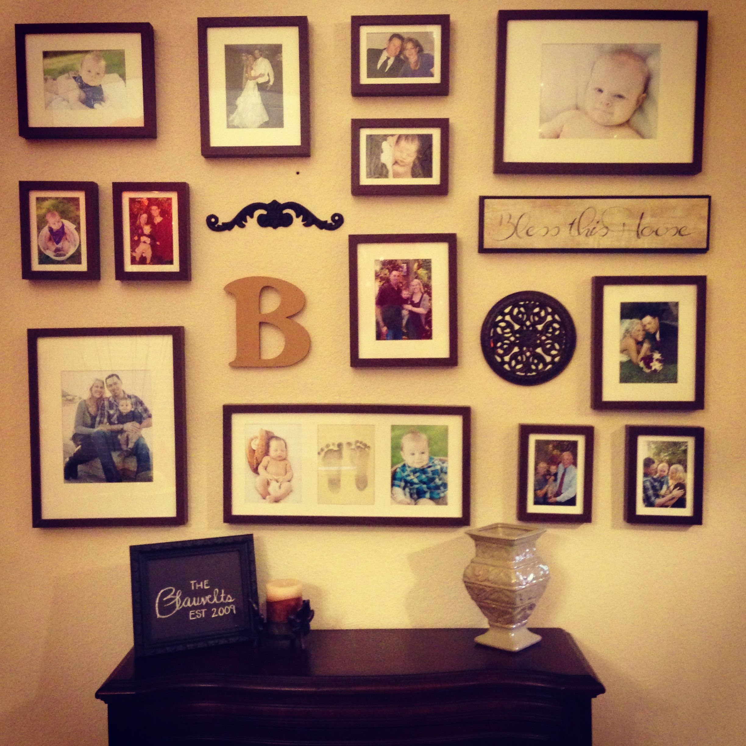 Photo collage wall :) love it!...but straighter, and maybe a mirror ...
