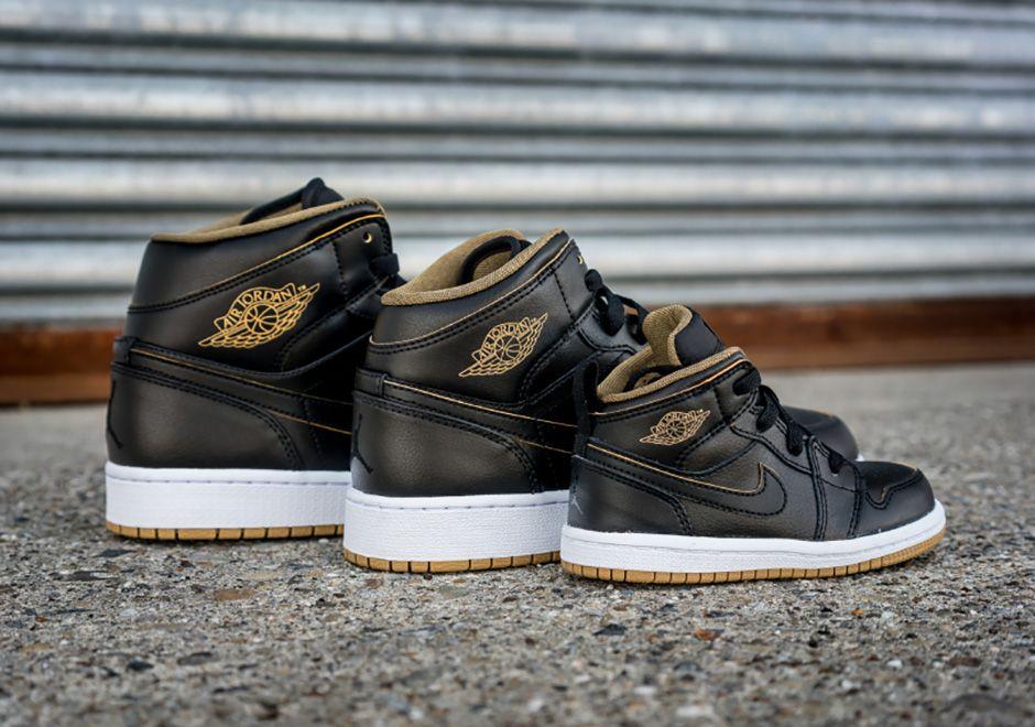 black and metallic gold jordans