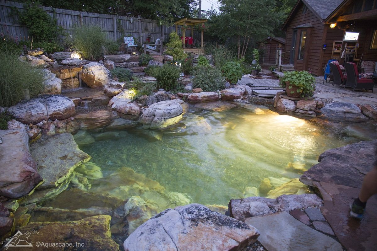 Pretty Backyard Lighting Ideas For Your Pond Waterfall Or Fountain Aquascape Inc Ponds Backyard Natural Swimming Ponds Swimming Pool Pond