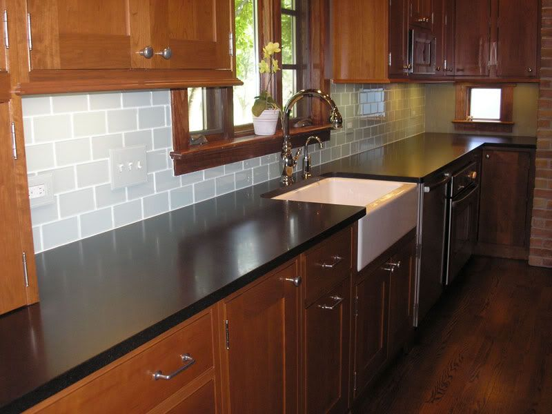 Chosing a backsplash with black granite counters ... on Backsplash Ideas For Black Granite Countertops And Cherry Cabinets  id=92365