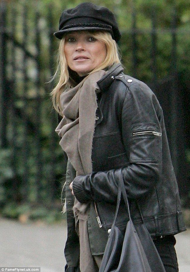 Out and about  Moss kept her hair protected from the winter weather with a baker  boy hat as she wore a black leather jacket f86cce6a97c