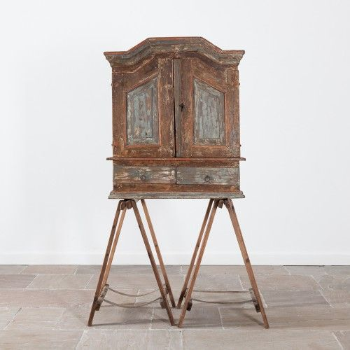 Early 19th Century painted Swedish cupboard. The cupboard has been dry scraped to reveal the original paint .  This charming cupboard is in good, solid condition.  Will look good wall mounted or sitting atop a table or chest.