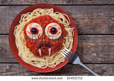 Funny halloween vampire face food for celebration party. Scary monster with big eyes, fangs and moustaches on vintage wooden background. Rustic style. - stock photo