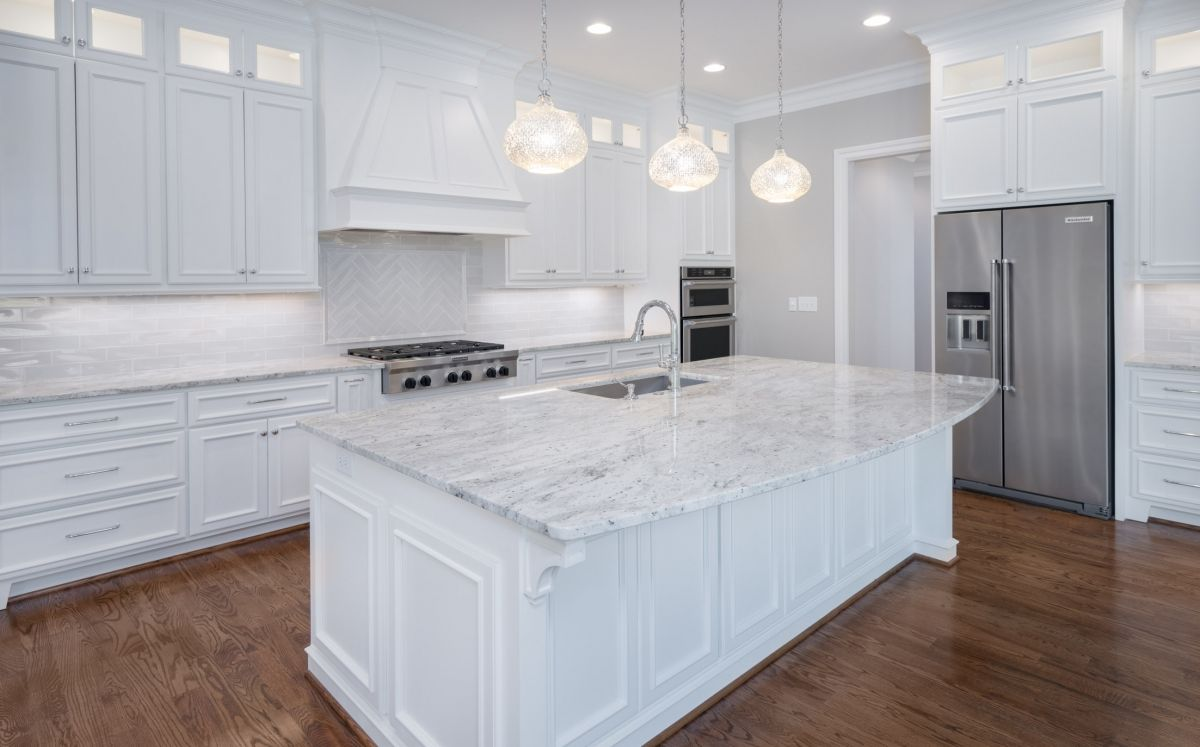 Gorgeous all white kitchen with large center island. Love the ...