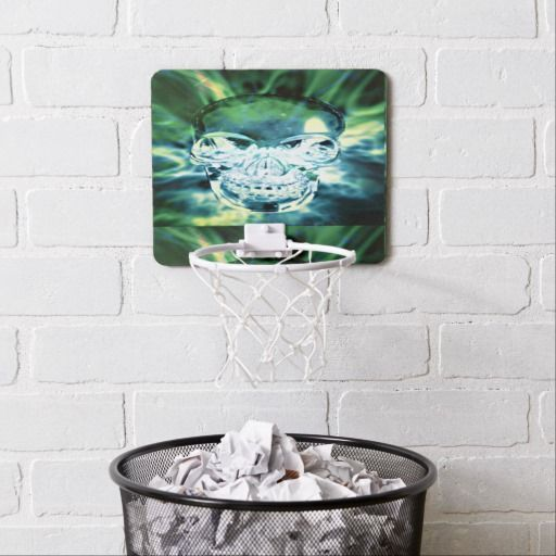 Green Aurora Crystal Skull Mini Basketball Backboard. The mini basketball hoop comes with velcro tabs for easy mounting anywhere – from above your wastebasket at work to the wall of a bedroom.