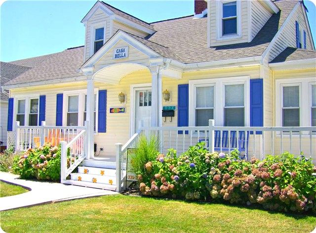 This Is Crazy Bright But I Love The Porch And The Yellow Siding
