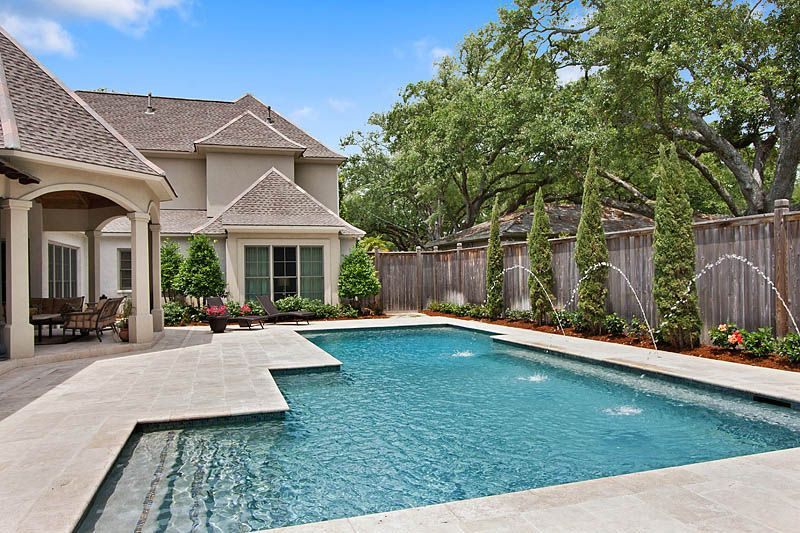 Custom Gunite Swimming Pool With Travertine Decking River Rock Plaster And Deck Jets Built By Lucas Firmin Pools In Baton Rouge Swimming Pools Building A Pool Pool Houses