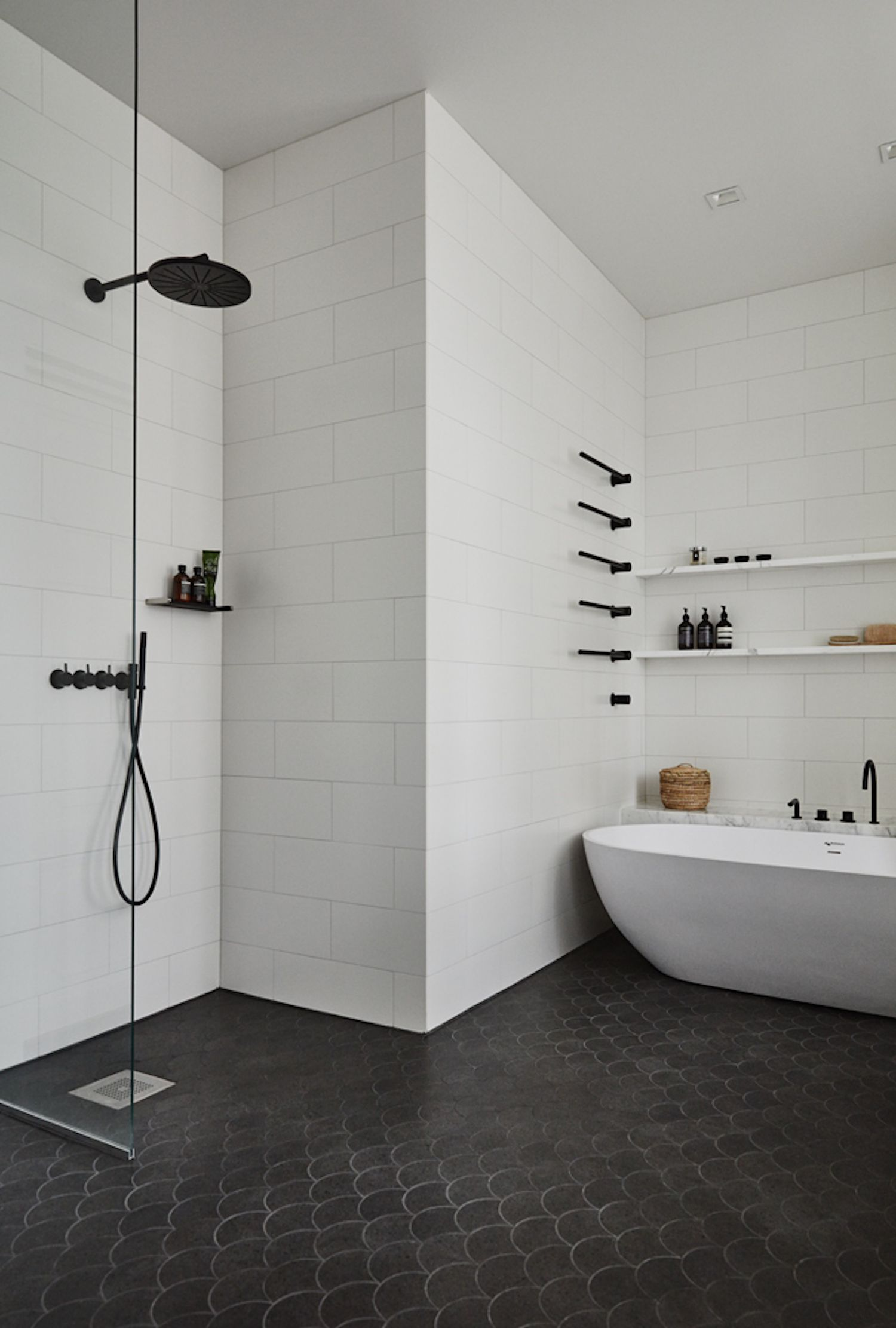 Striking black fixtures and fish scale tile in the bathroom of a home in  Lahti  Finland with interior design by Joanna Laajisto Lahti Home   Joanna Laajisto   est Living   spaces   bathroom  . In The Bathroom. Home Design Ideas