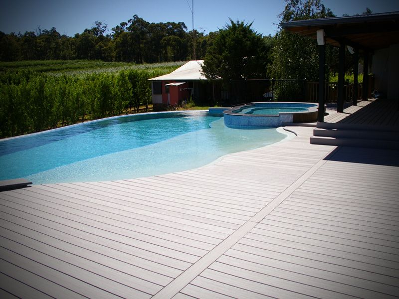 Inimitable Composite Decking Around Pool With Beach Entry Swimming Designs Also Infinity Edge Design From Tiles Decks