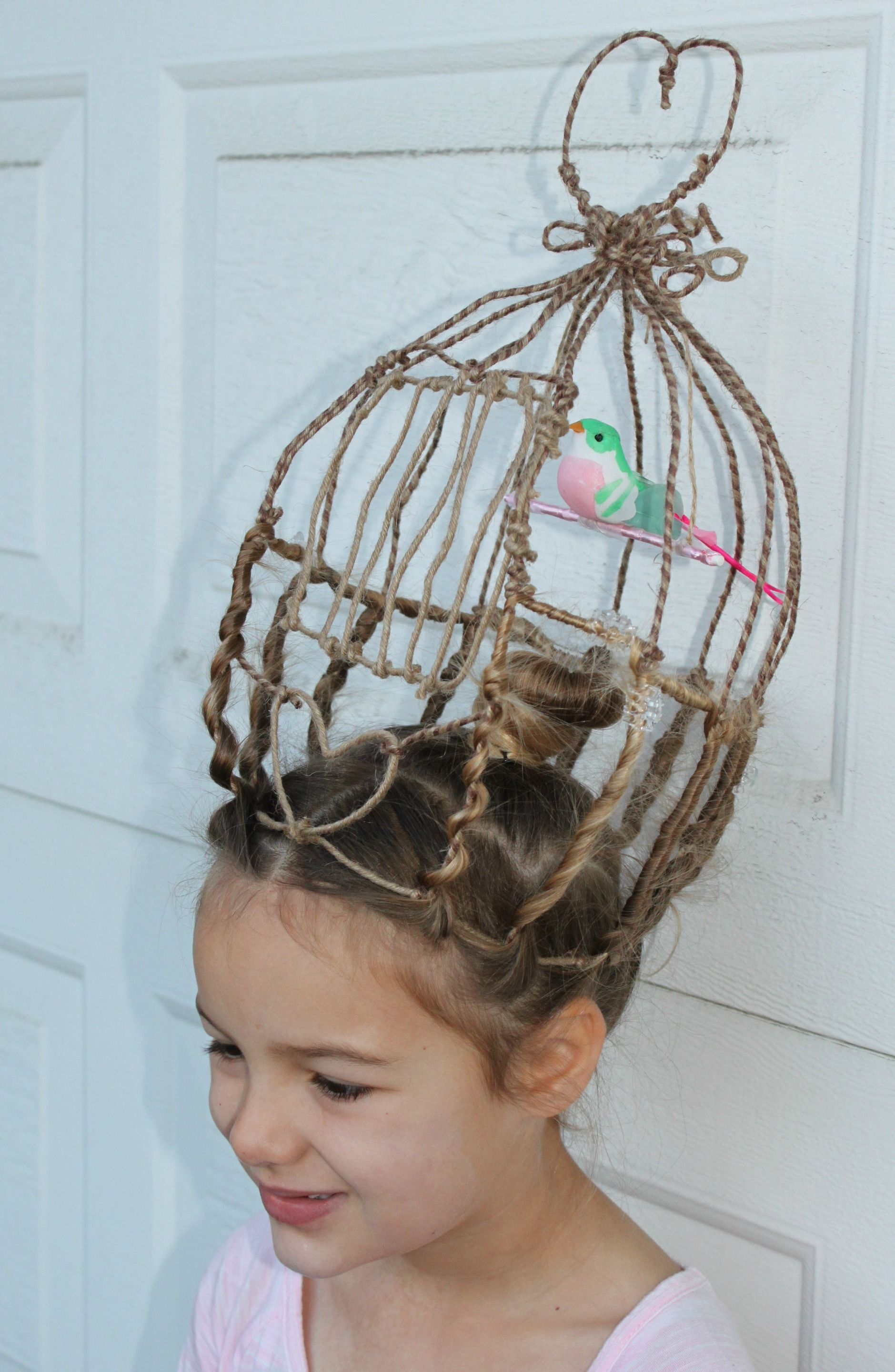 crazy hair day at school! birdcage , bird swinging on perch