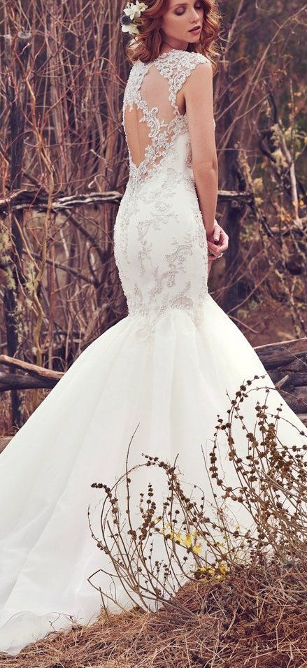dbb652fd9c0 The Ultimate Guide to Wedding Gowns for Curvy Brides from Whitney of  CurveGenius - The Payson wedding dress by Maggie Sottero has a  close-fitting bodice and ...