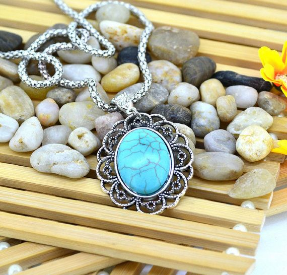 Turquoise Necklace Pendant presents a high quality craftsmanship and great turquoise stone surrounded by elaborate ornaments.