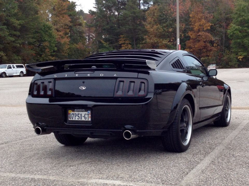 Black 2007 Ford Steeda Mustang Gt With Silver Horse Racing Rear Quarter Window Louvers Mrt Rear Louvers Axis Sport Wheels Mustang Gt Mustang Ford Mustang Gt