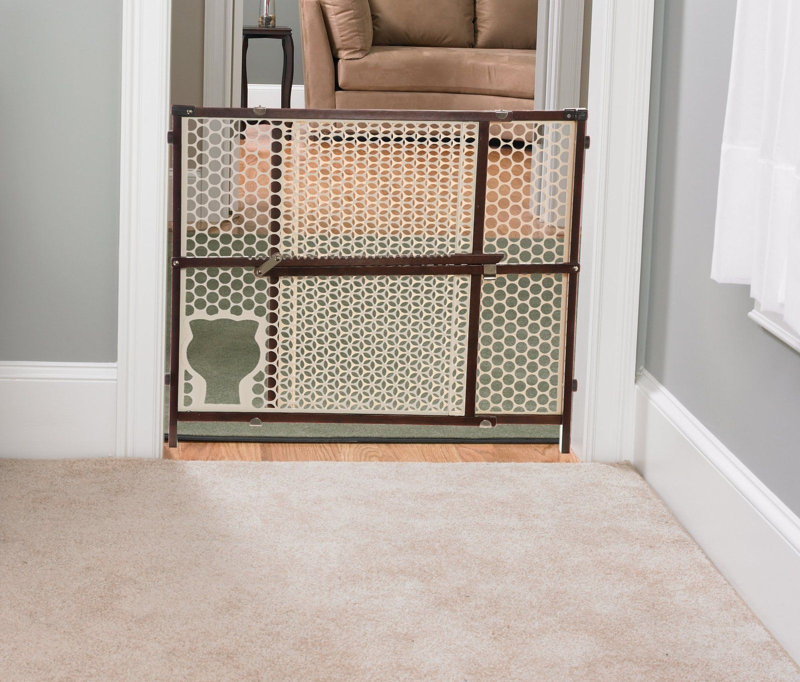 The Safety 1st Baby N Pet Gate Allows Small Pets To Pass Through,