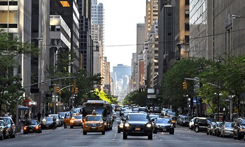 Traffic surges up Third Avenue at 49th Street.