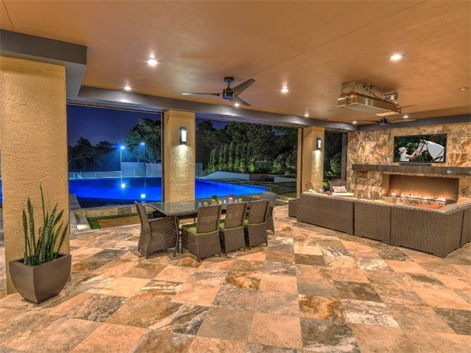 Covered Patio With Fireplace And Tv Of Luxury Home In Ormond Beach Florida With Images Patio Ormond Beach Outdoor Living