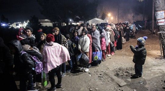 Migrants from Syria wait in line to cross the border near the northern Greek village of Idomeni on November 26, at the Greek-Macedonian border. (Milos Bicanski/Getty Images)