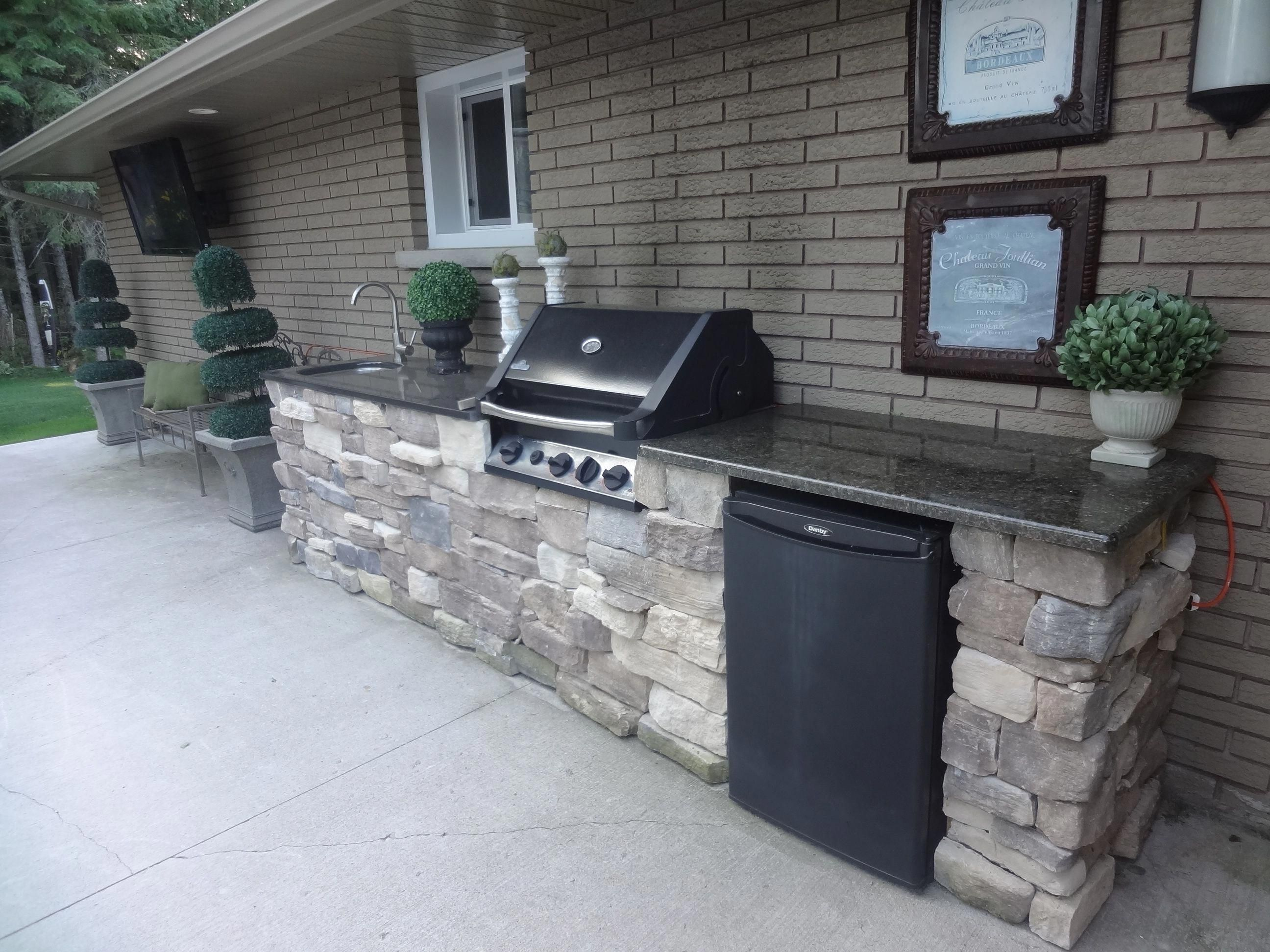 Hereus our old house the custom outdoor kitchen granite tops