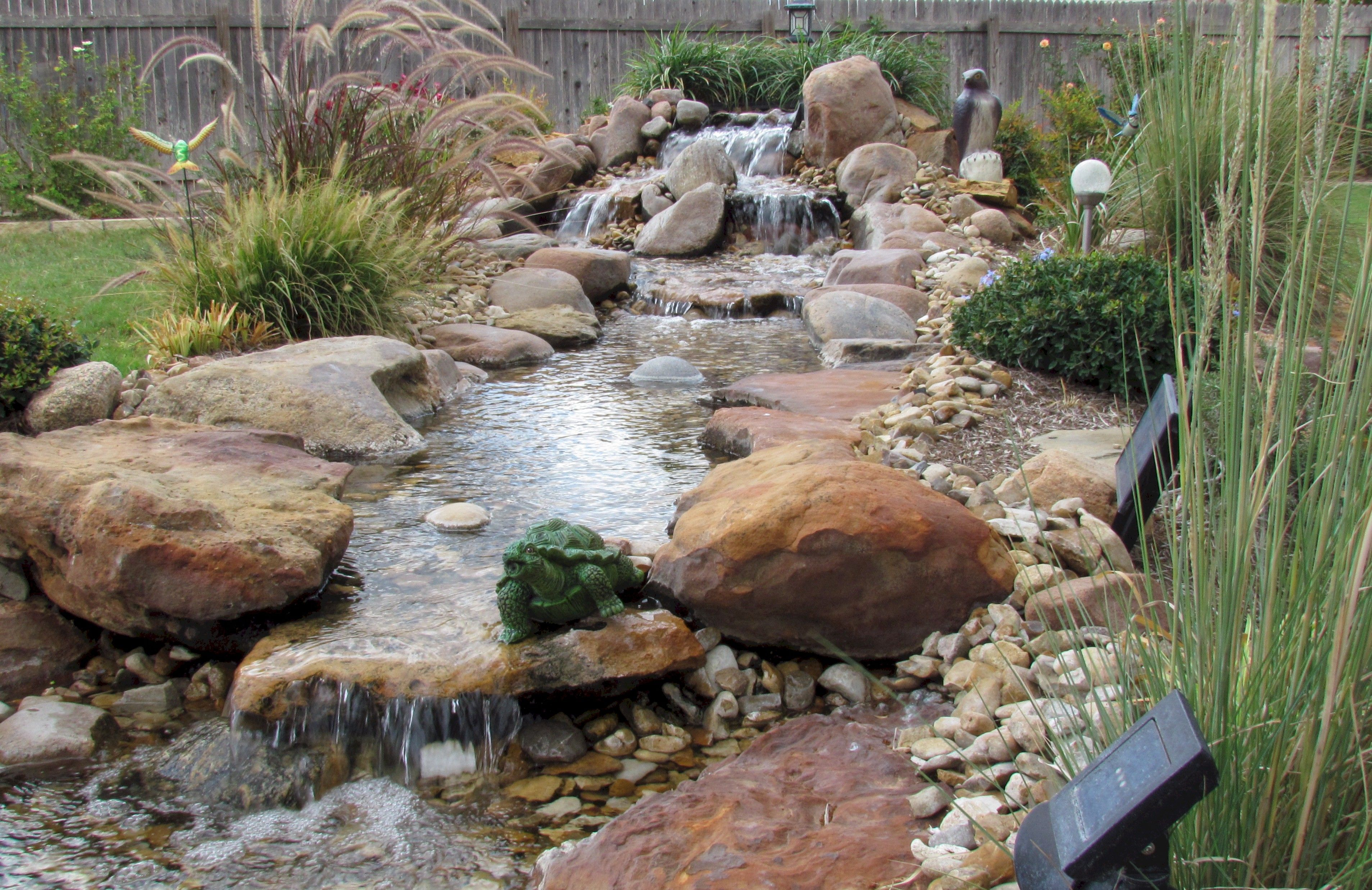 image result for diy backyard waterfall and stream outside