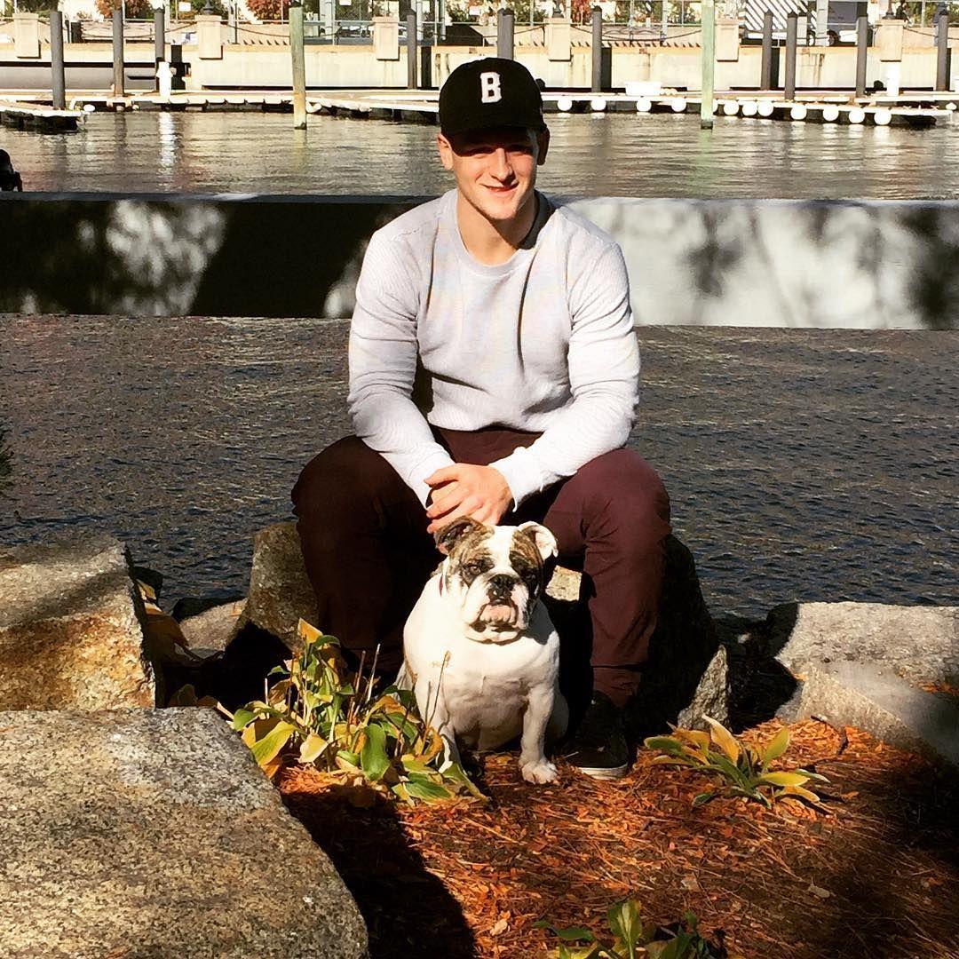 It Was A Perfect Boston Day For Some More Pucks And Pups Calendar Shoots Torey Krug And His English Bulldog Fenway Took T Boston Bruins Bruins English Bulldog