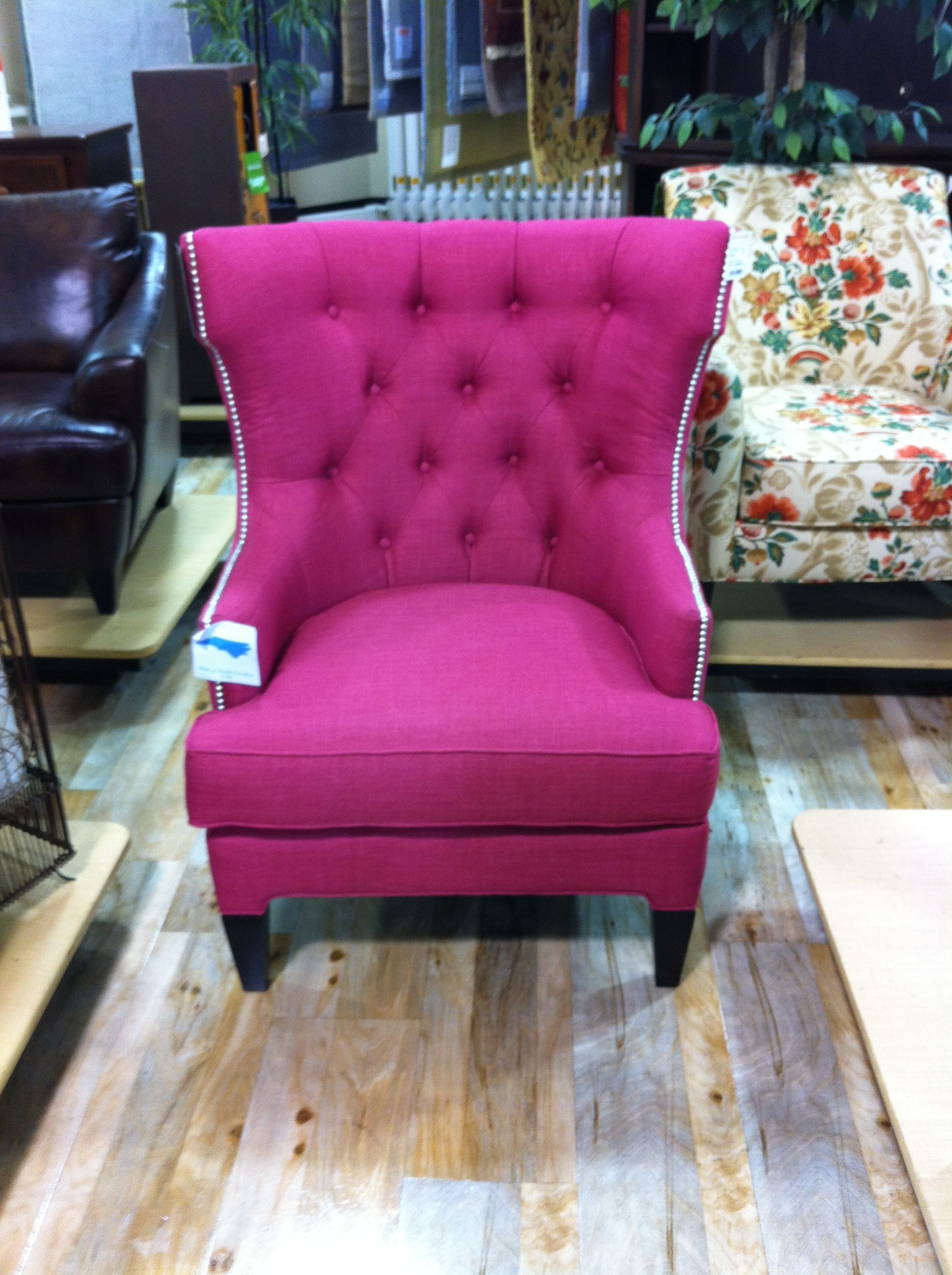 Pink wingback tufted chair with nailhead trim from