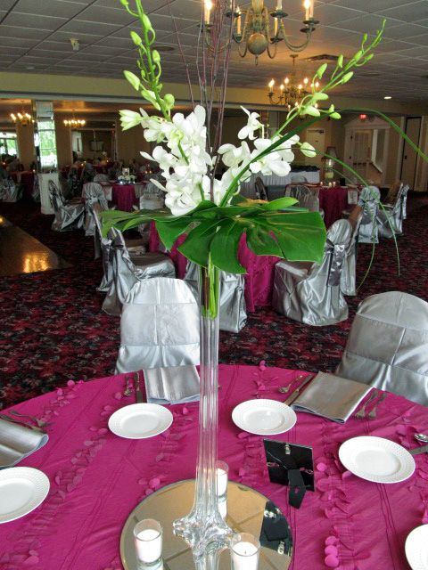 Eiffel Tower vase of Orchids & Monstera leaf centerpiece at Bel-Wood ...