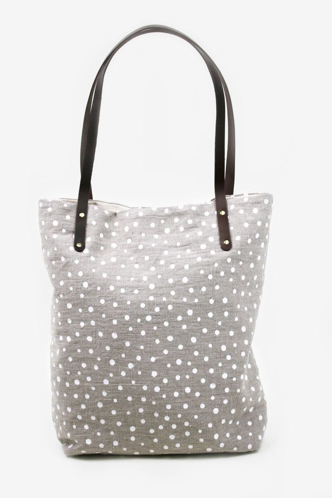 This large screen-print linen tote bag with brown leather handles features a polka-dot design, which never go out of style. www.mooreaseal.com