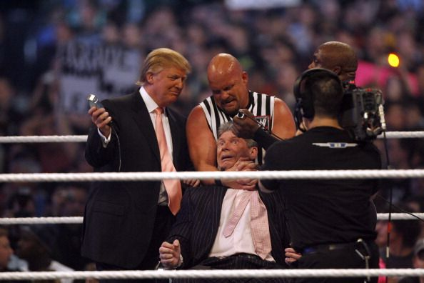 Donald Trump Stone Cold Steve Austin and WWE wrestler Bobby Lashley get ready to shave Vince McMahon's head after McMahons lost the main event of the...