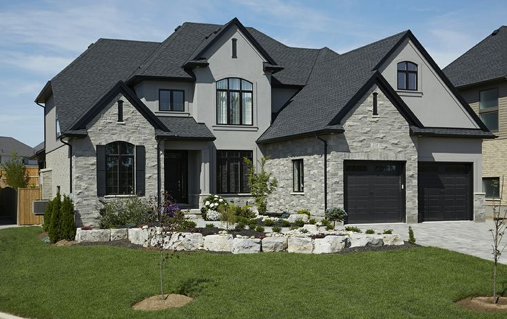 Stucco And Brick Exterior again, grey brick instead of stone, blended grey stucco, black