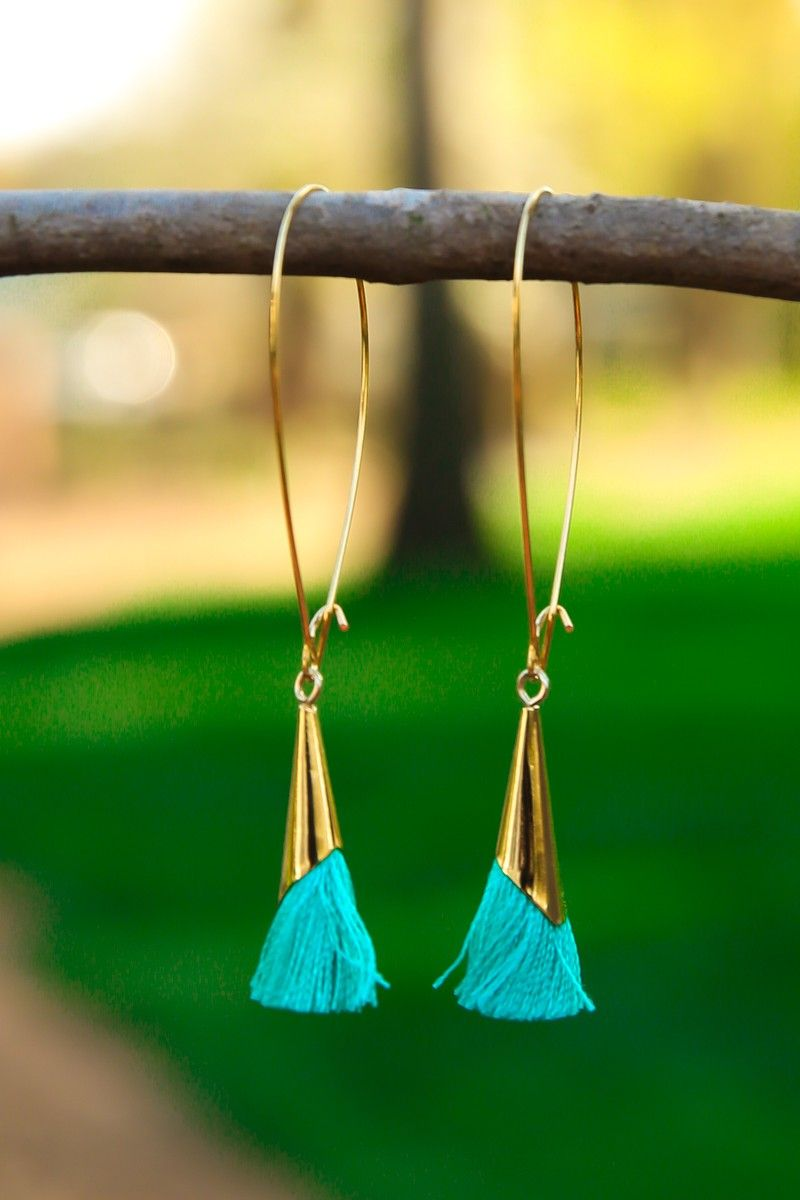 """You've got killer style, a dazzling smile, and """"To Cap It Off"""", you've got the brains and heart to match. Show them that you've got it all with this trophy of an earring. Tassel earrings with a gold cap on a kidney wire back. • Locally Made in Athens, GA"""