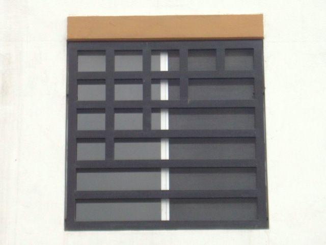Fotograf a de dise o de protecciones de ventanas for Diseno de puertas