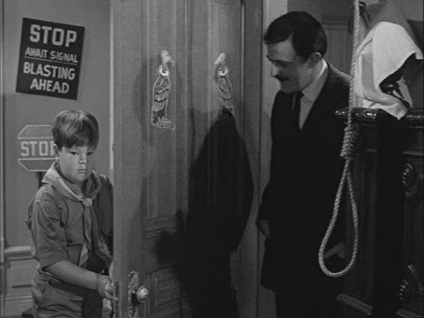 Pugley's room. Note the noose on the right hand of the door.