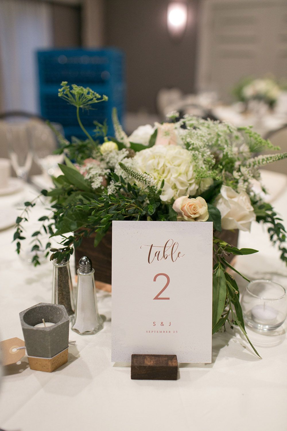 Organic and rustic centerpiece at the Woodcliff Hotel. #stacykfloral #weddingcenterpiece #tablenumbers #weddingtable