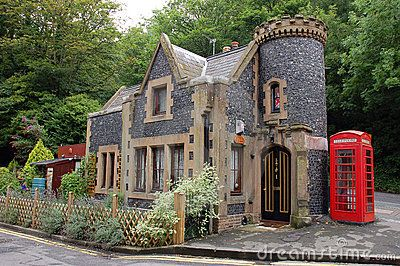 Tiny castle in england with red phone booth small house for Mini castle house plans