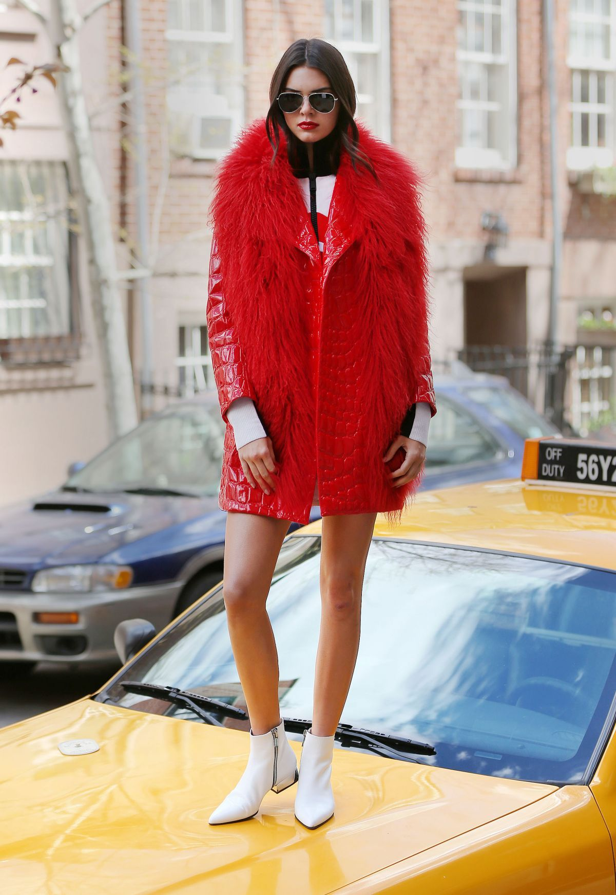 Kendall Jenner red leather and fur trimmed coat