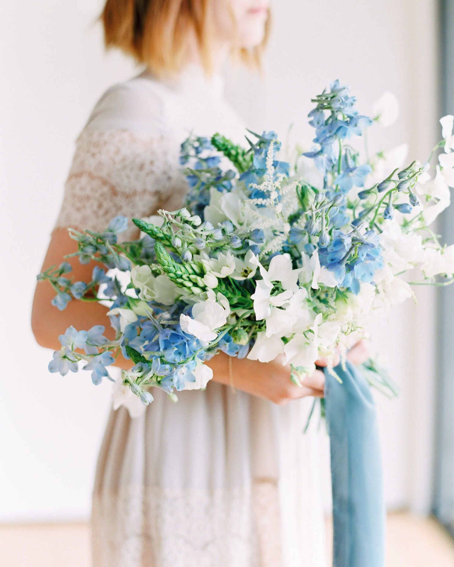 21 Ways To Use Delphinium In Your Wedding Bouquet Flower Bouquet Wedding Delphinium Wedding Bouquet Wedding Flower Guide