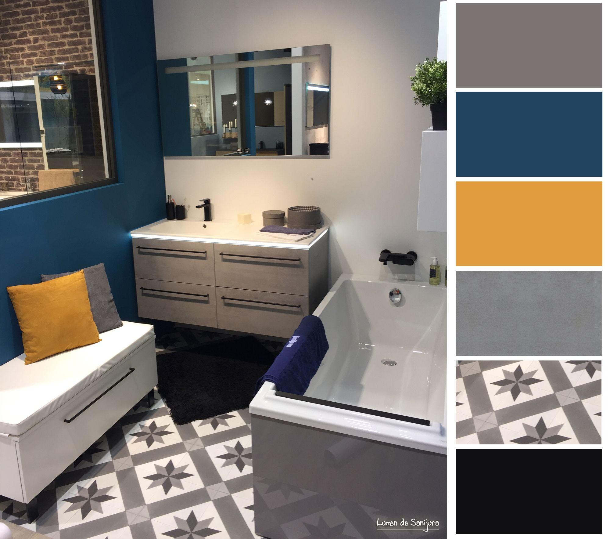 Profitez de votre petit espace pour cr�ee une salle de bain design ! M�lange de gris et de bleu canard, pour cette salle de bain originale et contemporaine. Un meuble en b�ton gris avec un bandeau LED pour une lumi�re douce. Le + d�co : le sol effet carre